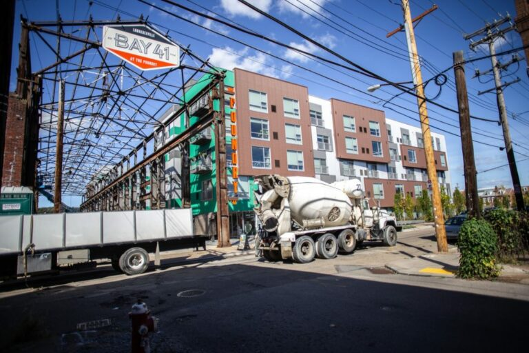 A cement truck passes by Foundry 41 at 41st and Willow streets in Lawrenceville.