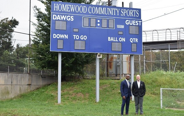Pro Football Hall of Fame Curtis Martin and Dan Towriss, CEO of Group1001 at Willie Stargell Field in Homewood.